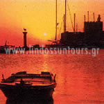 Sunset by the port : Lindos Suntours Official site : Lindos Hotel, Lindos Apartments, lindos Studios, Lindos Villas